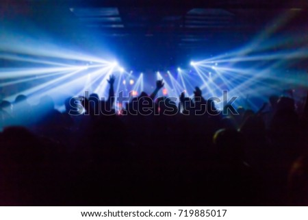 Effects blur Concert, disco dj party. People with hands up having fun #719885017