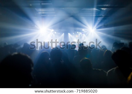 Effects blur Concert, disco dj party. People with hands up having fun #719885020