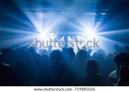Effects blur Concert, disco dj party. People with hands up having fun #719885026