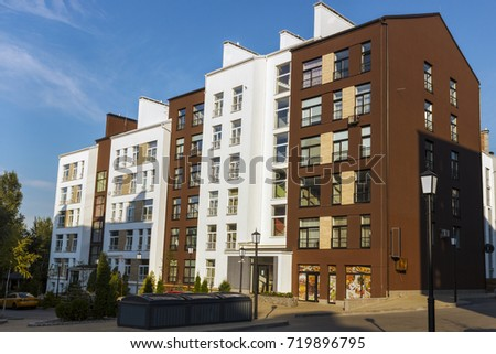 """Belogorodka, Ukraine - September, 2017: Complex of houses """"White Chocolate"""" with white-brown facades and roofs. #719896795"""