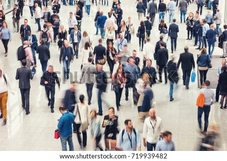 Crowd of people in a shopping center #719939482
