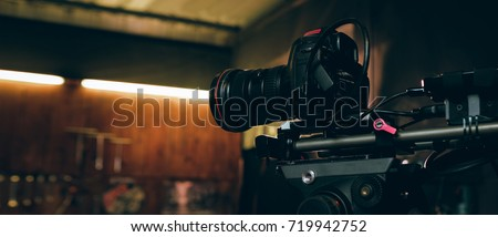 Camera dslr is shooting with dolly workshop background