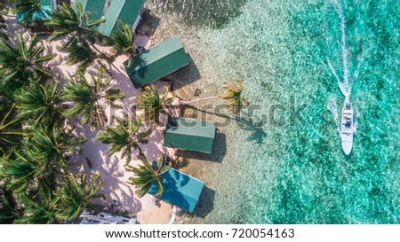 Tobacco Caye aerial in Belize barrier reef with boat #720054163