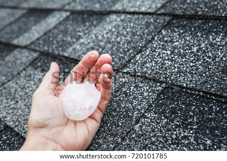 Hail in hand on a rooftop after hailstorm #720101785
