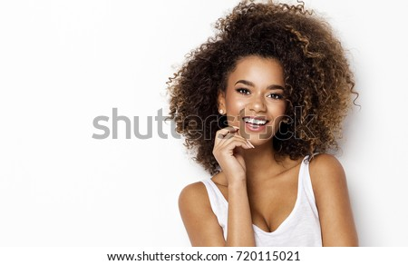 Portrait of smiling young black woman with copy space #720115021