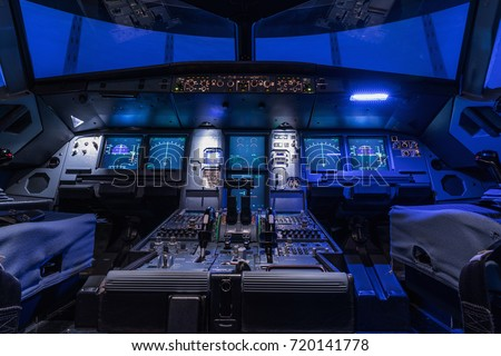 A view of the cockpit of a large commercial airplane, a cockpit trainer. Cockpit view of a commercial jaircraft cruising #720141778