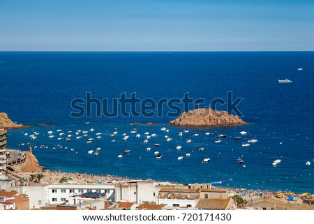 View of the town of Tossa de mar, city on the Costa Brava. Buildings and hotels by the beachl. Amazing city in Girona, sea and moored boats in Catalonia. #720171430