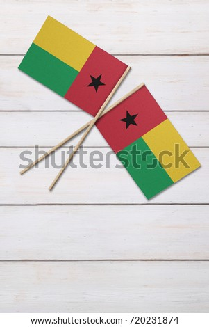 Two flags on a painted wood background #720231874