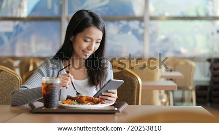 Busy woman having lunch and using cellphone  #720253810