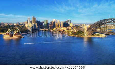 Aerial  panorama of Sydney city landmarks across Harbour from the Harbour bridge to CBD, circular quay and domain.  #720264658