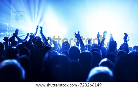 cheering crowd at a rock concert #720266149