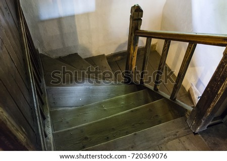 Old wooden staircase with railing and wall. #720369076