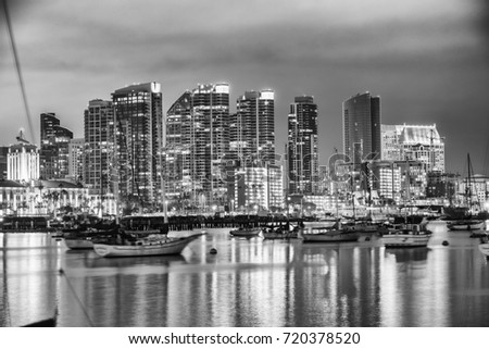 San Diego, California. Night view of Downtown buildgs with water reflections. #720378520