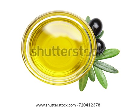 Bowl with olive oil isolated on white Royalty-Free Stock Photo #720412378