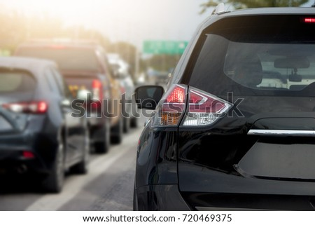 Cars on the road heading towards the goal of the trip in traffic junction. #720469375