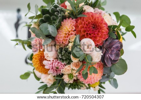 bright wedding bouquet of summer dahlias and roses #720504307