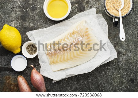 Cod fillets with melted butter and breadcrumbs before cooking in parchment paper. top view.  #720536068