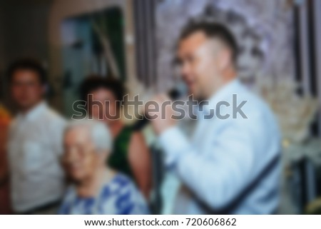 Blur people eating and talking in dining room, restaurant party celebration concept. #720606862