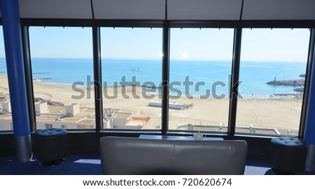 View of the beach from a restaurant in the lighthouse of Palavas city #720620674