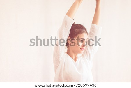 Teenage healthy girl is stretching ready for Yoga Spa Relax session #720699436