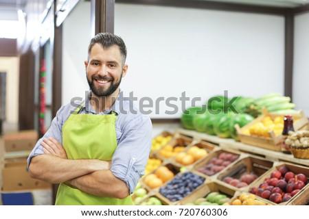 Seller in apron at market #720760306