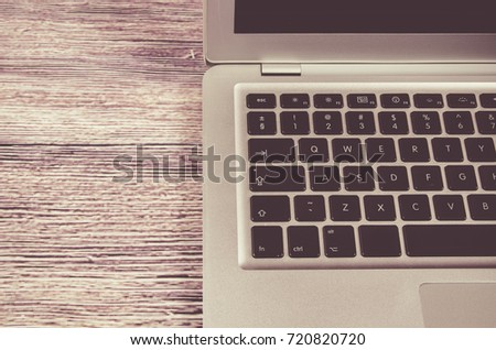 Modern laptop computer on dark background. The concept of work in the office. #720820720