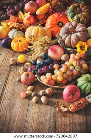 Vegetables pumpkins and fruits in autumn thanksgiving still life on wooden table Royalty-Free Stock Photo #720842887