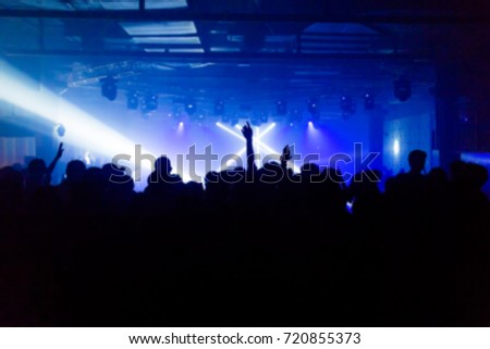 Effects blur Concert, disco dj party. People with hands up having fun  #720855373