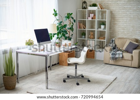 Background image of empty office space in cozy apartment with modern Scandinavian design Royalty-Free Stock Photo #720994654