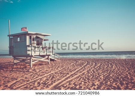Lifeguard cabin on Santa Monica beach in California on sunset, retro toned Royalty-Free Stock Photo #721040986