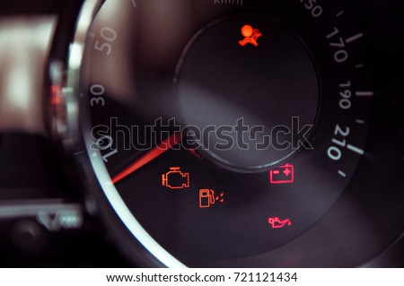 Many different car dashboard lights in closeup