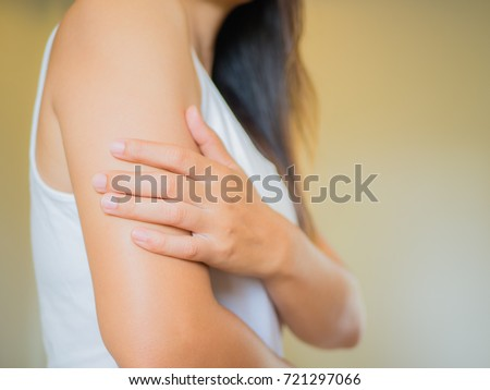 Closeup female's arm. Arm pain and injury. Health care and medical concept. Royalty-Free Stock Photo #721297066