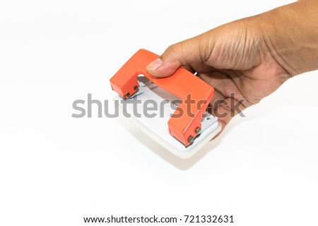 An orange paper punch on the hand of man isolated on white background #721332631