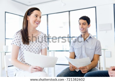 Image of business partners discussing documents and ideas #721382602