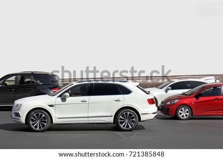Kiev, UA - May 3, 2017: Bentley Bentayga. White English SUV Bentley Bentayga in motion #721385848