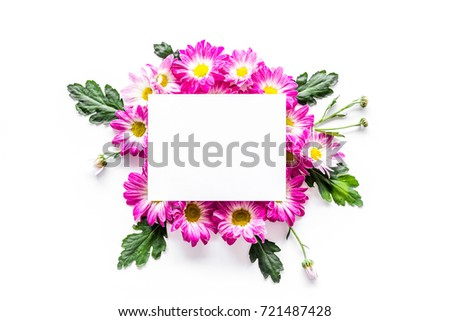Floral mockup. Sheet of paper in frame of pink flowers on white background top view #721487428