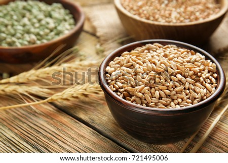 Wheat in bowl on kitchen table #721495006