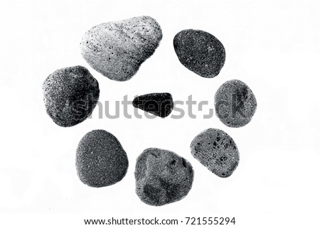 Sea pebbles forming a circle isolated on white. #721555294