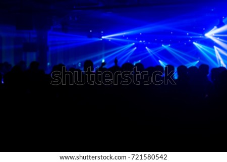Effects blur Concert, disco dj party. People with hands up having fun  #721580542