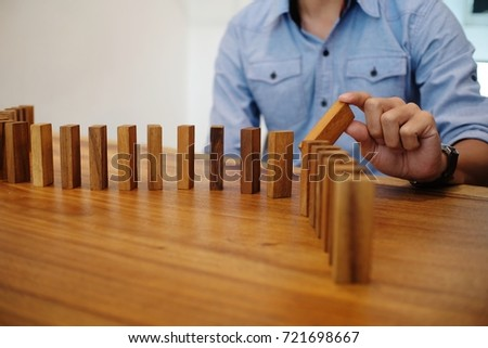Planning risk and strategy in businessman gambling placing wooden block.Business concept for growth success process. #721698667