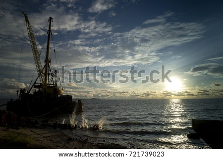 Silhouette crane  on sunset beach. #721739023