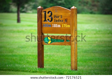 13 hole sign on golf course