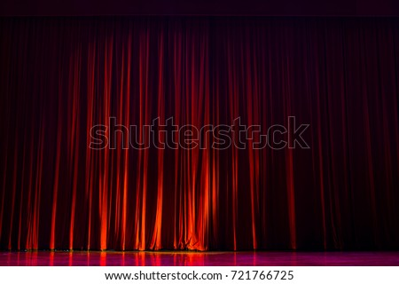 Red velvet curtains with the lights of the show and the wood flooring parquet. #721766725