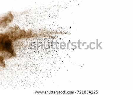 Brown Dust and Dry soil explosion on white background. Royalty-Free Stock Photo #721834225