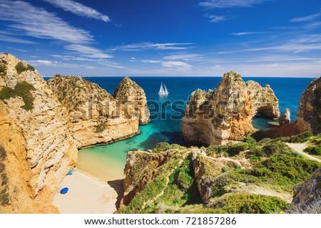 Beautiful bay near Lagos town, Algarve region, Portugal. Sandy beach. Portuguese landmark, popular travel destination Royalty-Free Stock Photo #721857286