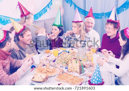 Adults with children are happy to celebrate childrenâ??s birthday during dinner. #721891603
