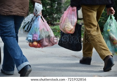 shopping with plastic bags, need to think about recycling #721932856