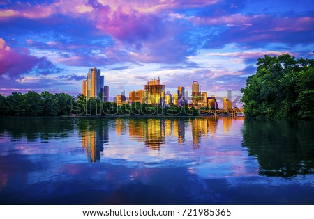 Austin Texas sunset glow off skyline cityscape reflections of golden hour at Lou Neff Point across town lake a tranquil purple and blue oasis dream land capital cities