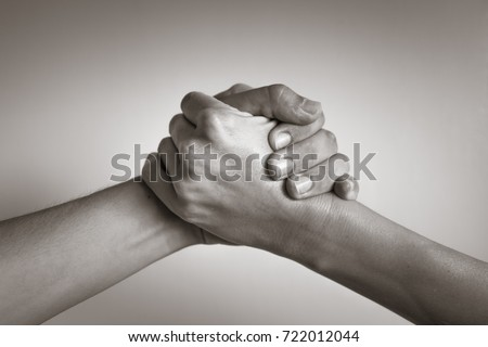 Hands coming together, helping hand. People working together, unity, agreement.  #722012044