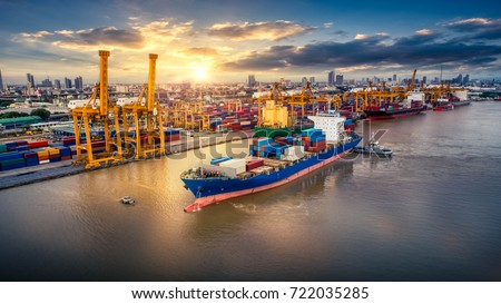 Logistics and transportation of Container Cargo ship and Cargo plane with working crane bridge in shipyard at sunrise, logistic import export and transport industry background, Aerial view from drone #722035285